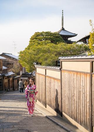 young woman in kimono walking in yasaka trail Reklamní fotografie