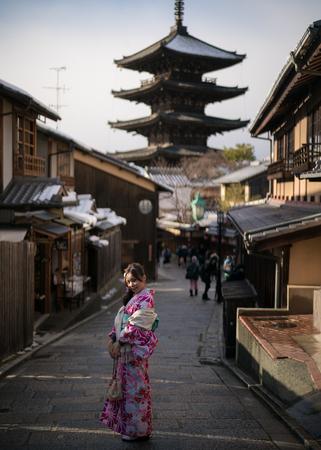 young woman in kimono at yasaka trail
