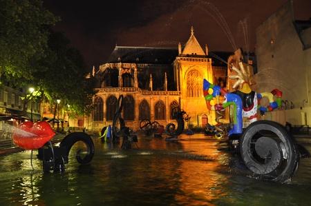 stravinsky fountain and saint merri church on night