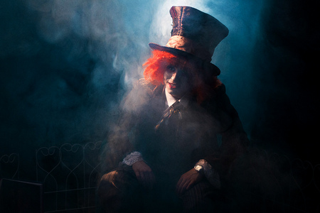 Portrait of a mad hatter among the smoke Stock Photo