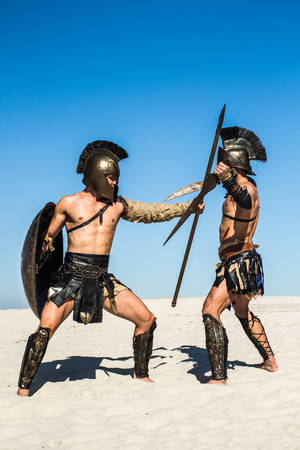 Furious battle of two legionaries in the middle of the desert Stock Photo
