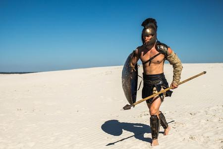 Spartan warrior runs to attack the desert