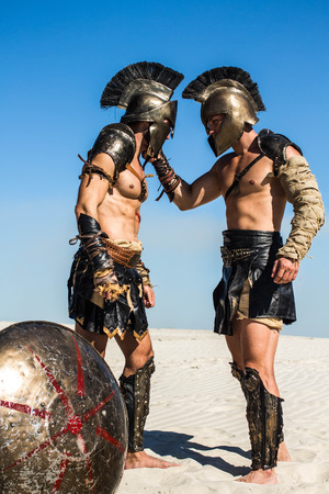 The Spartan warrior grabbed and held the Romans opponent by the helmet
