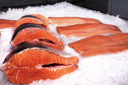 white salmon river: Fillet of salmon next to beautiful red steaks on ice Stock Photo