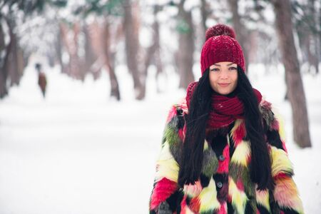 Young beautiful woman in a multi-colored fur coat Reklamní fotografie