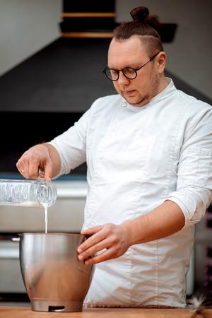 The chef prepares dough