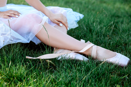 Sensual ballerina on nature in summer