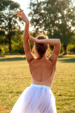 Sensual ballerina on nature in summer Reklamní fotografie - 106080388