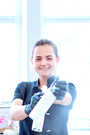 Woman in gloves and with antibacterial spray Stock fotó - 122228295