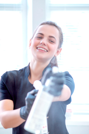 Woman in gloves and with antibacterial spray Stock fotó - 122228299