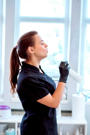 Woman in gloves and with antibacterial spray Stock fotó - 122228308