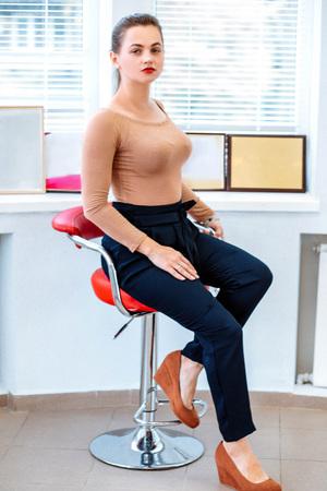 Successful modern business woman on the chair Reklamní fotografie - 122535343