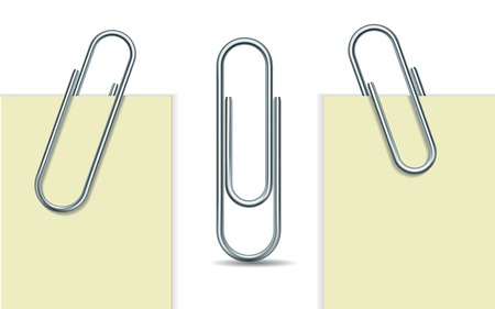 Metal paper clip and paper isolated on white background