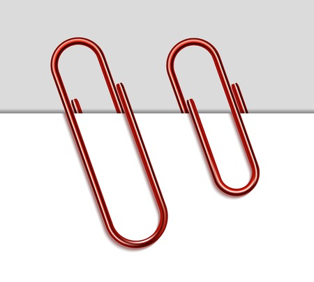 Red metal paper clip and paper isolated on white background