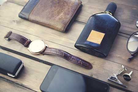 watches,glasses, wallet, perfume  and phone on wooden table Archivio Fotografico