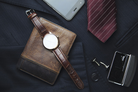 Men's wallet, watch, tie on suit