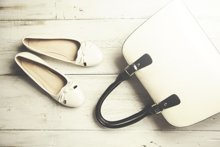 opentoe: Woman white  shoes and bag on wooden background