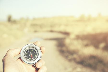Hand man holding compass navigator on road way Stock Photo