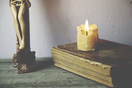 bible altar: cross, book and candle on wooden background Stock Photo