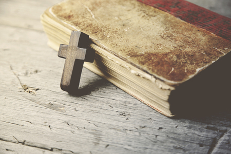 Crosses and book on a wooden table Stock Photo