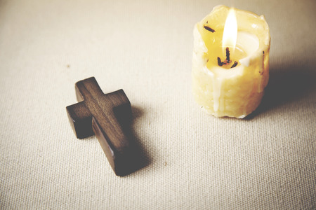 arrepentimiento: cross  and candle on white background