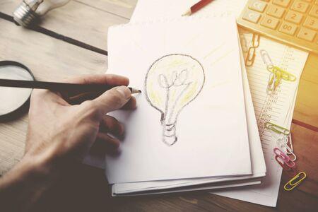 hand pencil: man hand pencil, man paints bulb