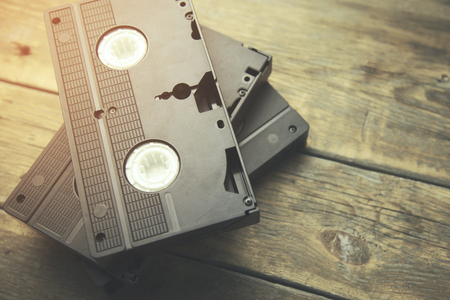 videocassette: old retro video tape over wooden background