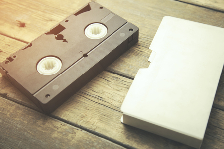 videocassette: old retro video tape on wooden background Foto de archivo