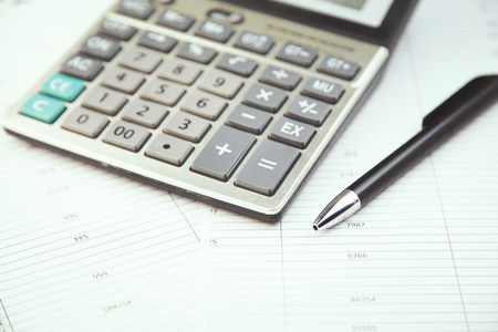 stationery items: calculator and stationery items on the table Stock Photo