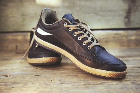 man  sneakers on the wooden floor