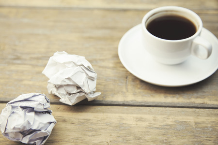 pencils  clutter: coffe cup and crumpled for idea on wood background