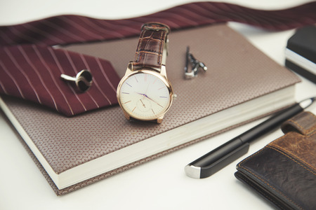 clothes organizer: Business accessories on desktop: notebook, diary, fountain pen, cufflinks and watch Stock Photo