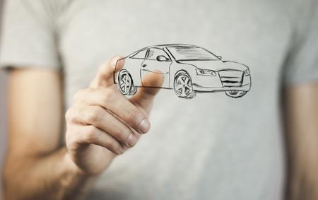 man hand holding car