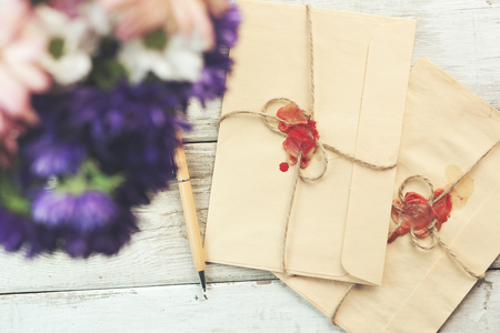 Letter love. Romantic envelope with flowers on the table.