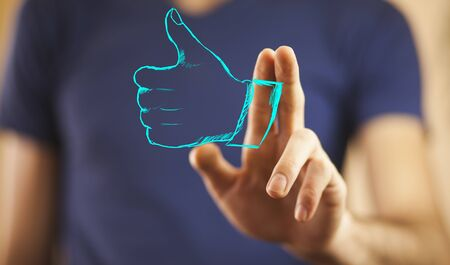 Man palm opening showing thumb up Stock Photo