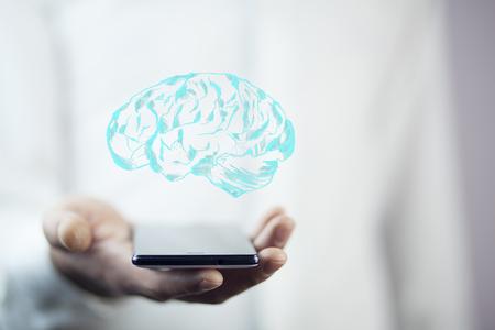 man hand phone with brain Stock Photo