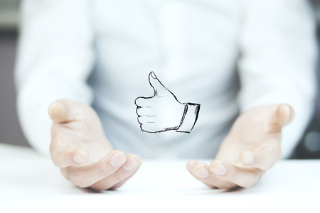 Man palm opening showing thumb up on white background