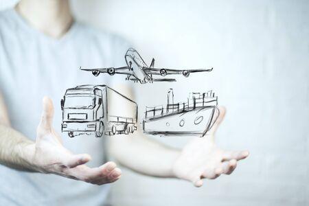 Businessmans hands holding different virtual transportation