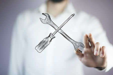 man hand  mechanic tools in the screen