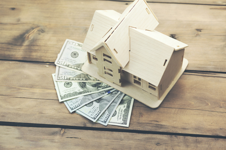 house model on  money on wooden table