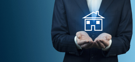 man hand blue house model in screen