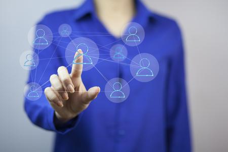 businesswoman   finger touching virtual button on gray background Stock Photo
