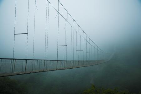 Swinging Bridge in fog in the Armenia Foto de archivo