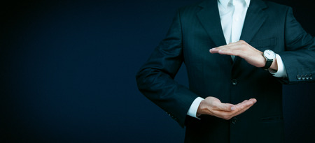 Businessman standing posture show hand isolated on over dark background