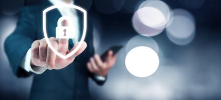 business man hand lock in screen on bokeh background