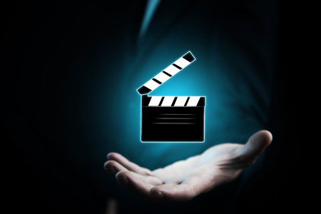 man hand with a movie clapper slapstick 版權商用圖片