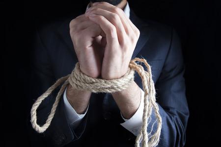 Closeup on a businessman's tied up hands. Фото со стока