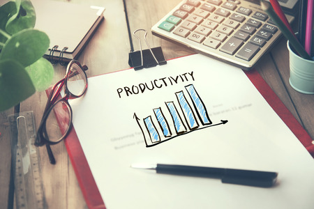 productivity text on page with stationary on table