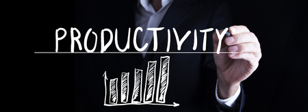 Man hand writing productivity word in screen Stock Photo