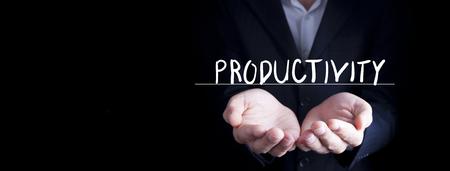 man hand productivity word in screen on dark background